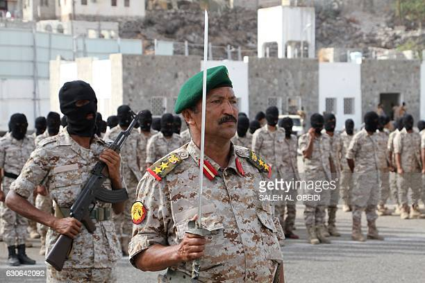 A Yemeni officer stands to attention as recruits from the counterterrorism forces attend a graduation ceremony on December 29 in the southern city of...