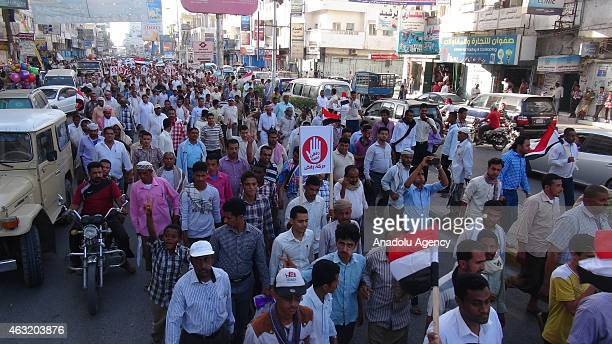 Yemeni people attend a rally within the commemoration events of the 4th anniversary of Yemens revolution in Al Hudaydah Yemen on February 11 2015