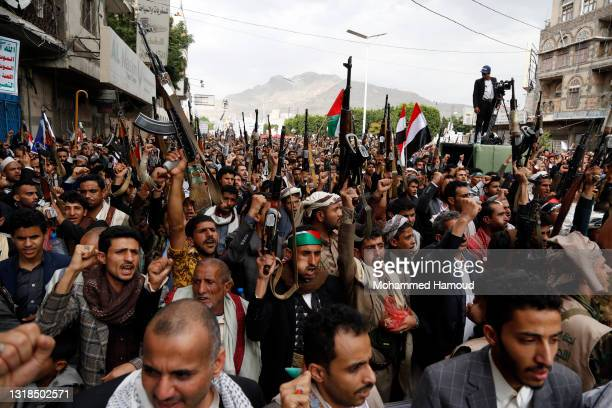 Yemeni people chant anti-Israel slogans during a protest in solidarity with Palestinians on May 17 in Sana'a, Yemen. Cross-border airstrikes between...
