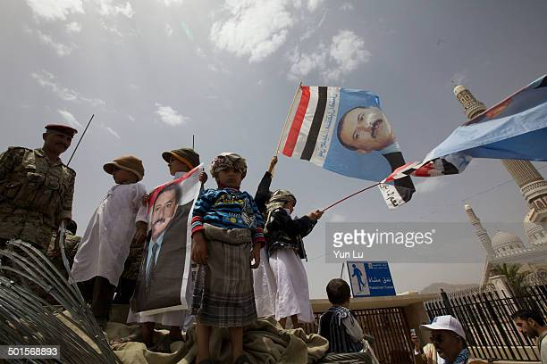 Yemeni people hold portraits of President Ali Abdullah Saleh as they attend a pro-regime rally in Sanaa on June 10, 2011 as loyalists celebrated news...