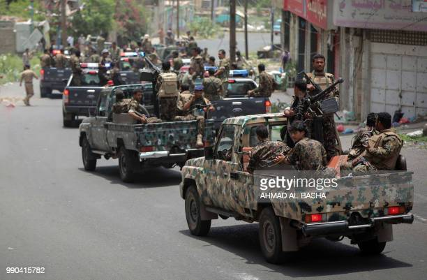 Yemeni police men patrol the streets of the southern city of Taez, on July 2, 2018. - A large portion of Yemen's third city Taez is held by...