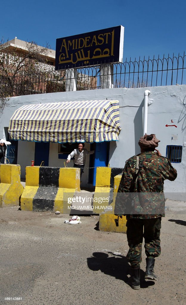 A Yemeni policeman stands in front of the American education and training organisation AMIDEAST, where a kidnapped British teacher works, on February 13, 2014 in Sanaa. Gunmen have abducted a British teacher in the Yemeni capital Sanaa, in the second kidnapping this month of a British expat in violence-hit Yemen, a security official said.
