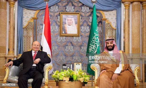 Yemeni President Abdrabbuh Mansur Hadi and Saudi Arabian Crown Prince Mohammed bin Salman Al Saud hold a meeting in Jeddah Saudi Arabia on May 31 2018