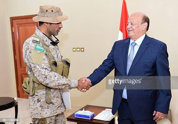 Yemeni President Abedrabbo Mansour Hadi shakes hands with Abdullah bin Sahyan who commands the Saudi forces in Yemen's southern port city of Aden...