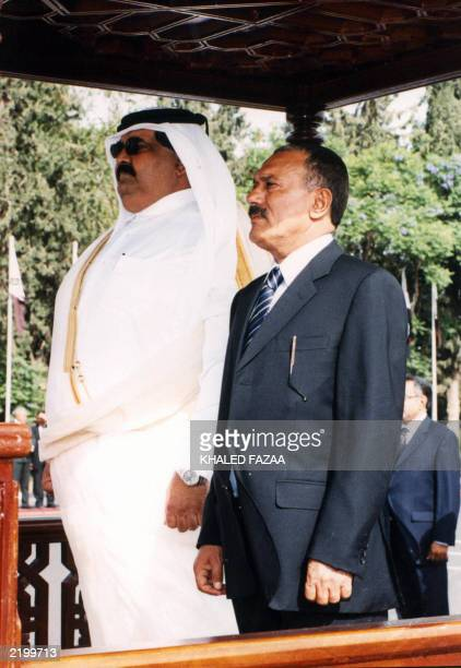 Yemeni President Ali Abdullah Saleh and Qatar's Emir Hamad bin Khalifa al-Thani stand to attention during the playing of the national anthem at Sanaa...