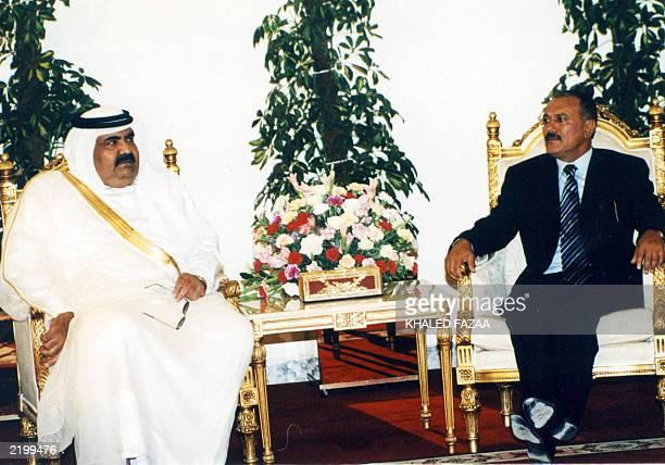 Yemeni President Ali Abdullah Saleh sits with Qatar's Emir Hamad bin Khalifa al-Thani during a meeting in Sanaa 11 June 2003. The emir is on an...