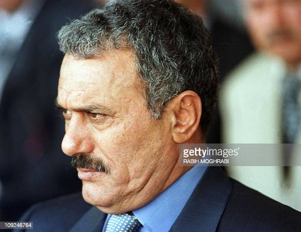 Yemeni President Ali Abdullah Saleh stands outside a polling station in Sanaa 23 September 1999 after casting his vote in the Arabian peninsula's...