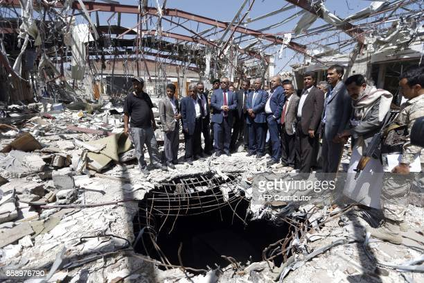 TOPSHOT Yemeni Prime Minister Abdel Aziz bin Habtoor visits the site of a funeral hall building destroyed a year ago by reported Saudiled coalition...