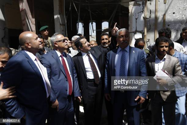 Yemeni Prime Minister Abdel Aziz bin Habtoor visits the site of a funeral hall building destroyed a year ago by reported Saudiled coalition...