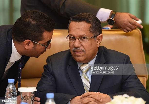 Yemeni Prime Minister Ahmed bin Dagher listens to his aide during a cabinet meeting of Yemeni ministerial council held in the Saudi capital Riyadh on...