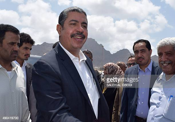 Yemeni Prime Minister Khaled Bahah welcomes workers from the Saudi King Salman Humanitarian Aid and Relief Centre who were on a boat carrying aid...