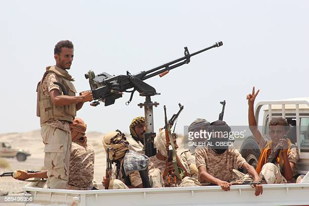Yemeni progovernment forces flash victory signs as they head to Zinjibar the capital of Yemen's southern province of Abyan to launch an offensive to...