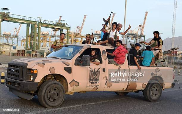 Yemeni progovernment forces loyal to exiled Yemeni President Abedrabbo Mansour Hadi sit in the back of a vehicle in the city of Aden on August 28...