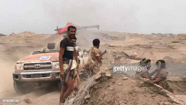 Yemeni progovernment forces man a barricade in the area of alFazah in Yemen's Hodeida province on June 16 2018 The UN envoy for Yemen carried a plan...