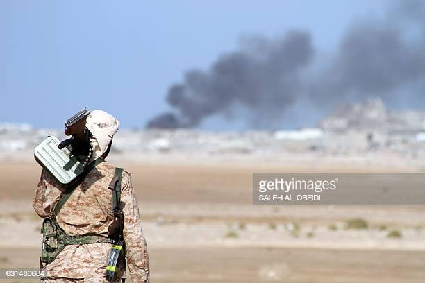 TOPSHOT Yemeni progovernment forces patrol during clashes against Shiite rebels in Yemen's western Dhubab district about 30 kms north of the...
