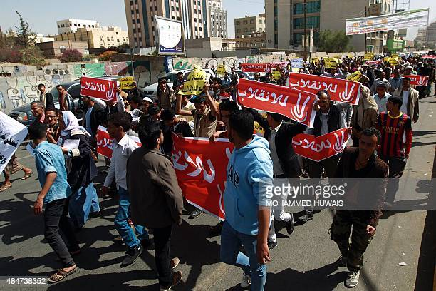 Yemeni protesters hold banners reading in Arabic 'No to the coup' during a demonstration against the Shiite Huthi movement which overran the capital...