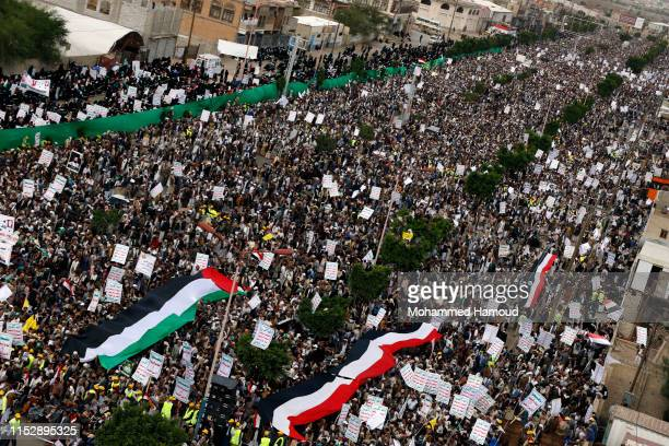 Yemeni protesters loyal to Houthi movement take part in a protest held to mark the International Quds Day on May 31 2019 in Sana'a Yemen