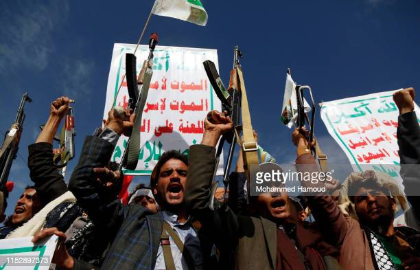 Yemeni protesters loyal to Houthi movement take part in a protest held to mark the International Quds Day on May 31, 2019 in Sana'a, Yemen.