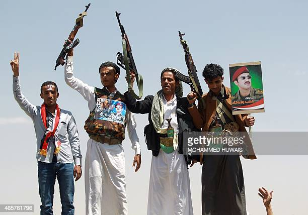 Yemeni protesters raise their weapons during a demonstration in the capital Sanaa on March 10 demanding Ahmed Ali Abdullah Saleh the son of Yemen's...