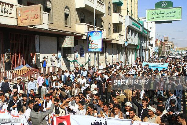Yemeni protesters shout slogans during a demonstration against the presence of Shiite militiamen in the capital and also against attacks by AlQaeda...