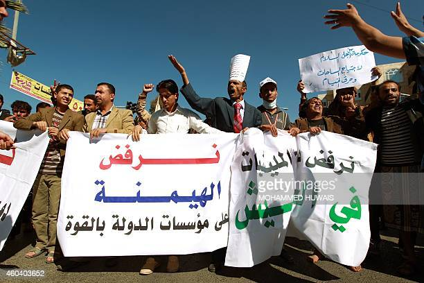 Yemeni protesters shout slogans holding banners during a rally against the control of the countrys main cities by Shiite Huthi rebels on December 13...