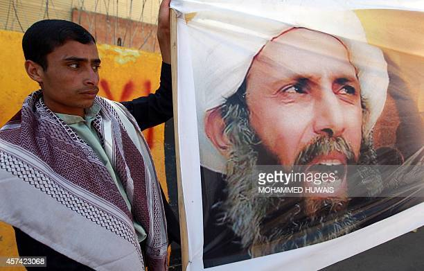 Yemeni protesters take part in a demonstration outside the Saudi embassy in Sanaa against the death sentence on Shiite cleric and antigovernment...