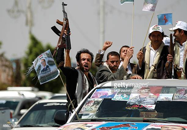 Yemeni protesters wave thier weapons as they take part in a demonstration in Yemen's militiacontrolled capital Sanaa calling for presidential...