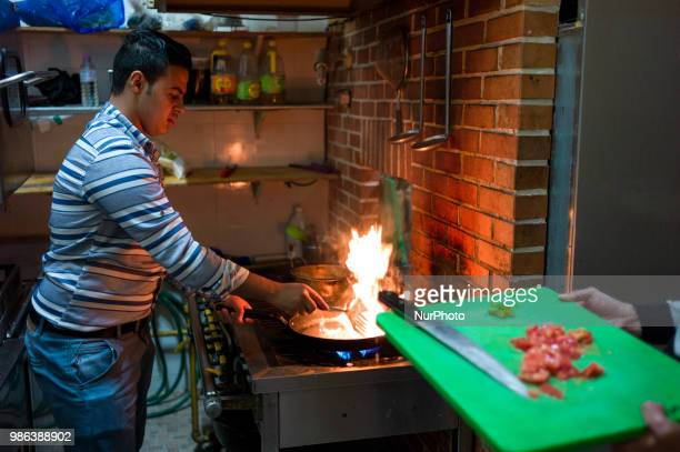 Yemeni refugee applicant is cooking omelets for dinner at the hotel kitchen in Jeju Island South Korea on June 28 2018 With the consideration by the...