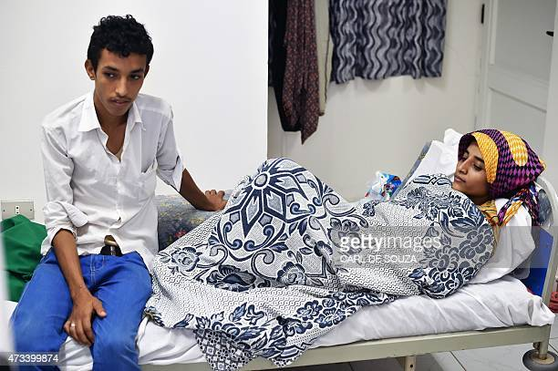 Yemeni refugee Mohamed Nasser Mahdi sits next to his wife Wida Faysal Abdou at the Djibouti hospital on May 5 2015 Each day they come from the...