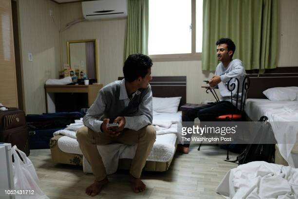 Yemeni refugee Mohammed alAbab and his roommate Hamza Adel sits in their hotel room in Jeju South Korea Al Abab and Adel share the twin room with two...