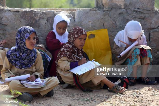 Yemeni school children attend an open-air class at their unfinished school on September 16, 2019 in the southwestern Yemeni village of al-Kashar in...
