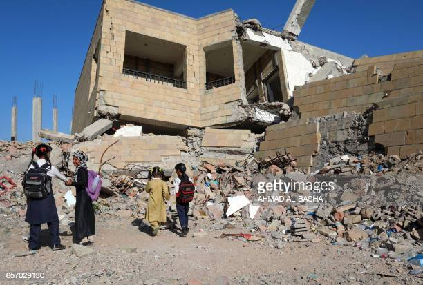Yemeni school children walk outside a school on March 16 that was damaged in an air strike in the southern Yemeni city of Taez The conflict in Yemen...
