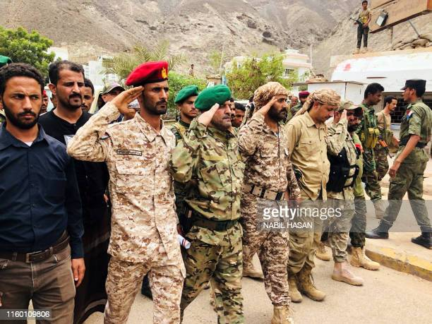 Yemeni security forces attend the funeral of their comrades, who were killed in two separate attacks in the Sheikh Othman area earlier in the month,...