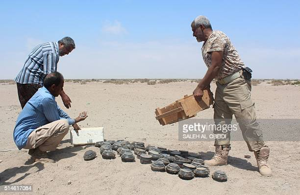 Yemeni security forces inspect unexploded ordnance confiscated from the Shiite Huthi rebels and militant extremists as they prepare to neutralise the...