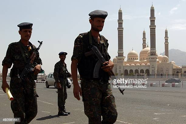 Yemeni security forces patrol past the alSaleh mosque in the capital Sanaa on May 21 2014 during a rally marking the twoyear anniversary of a suicide...