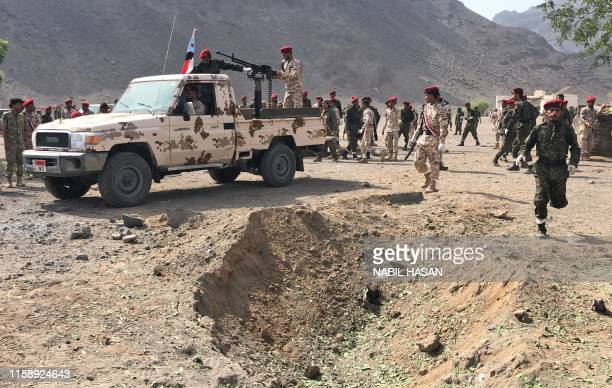 Yemeni security forces rush to the scene of a missile attack on a military camp west of Yemen's governmentheld second city Aden on August 1 2019...