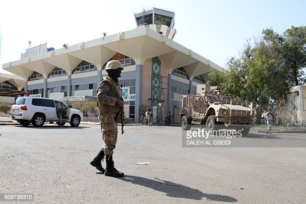 Yemeni security forces stand guard outside Aden Airport on September 22 upon the arrival of Yemen's premierinexile and seven ministers Prime Minister...