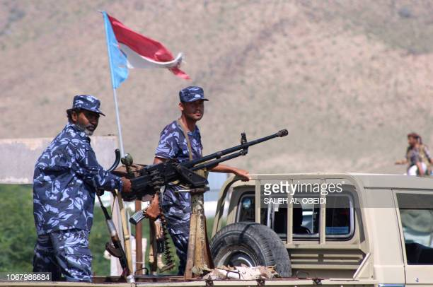 Yemeni security forces stand on the back of a pick up truck mounted with a heavy machine gun at a checkpoint in the former AlQaeda in the Arabian...