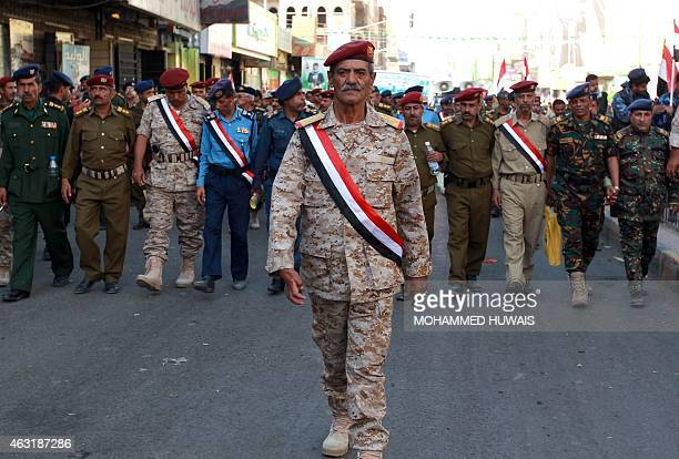 Yemeni security forces supporters of the Shiite Huthi movement take part in a rally to commemorate the fourth anniversary of the start of the...