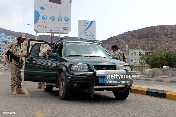 Yemeni security forces take security measures after an assassination attempt to Adens security chief Brigadier Shalal Ali Shayea in Aden Yemen on...
