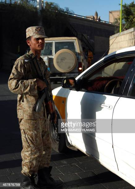 A Yemeni security guard mans a checkpoint in the capital Sanaa On December 19 2013 AlQaeda in the Arabian Peninsula has stepped up attacks on...