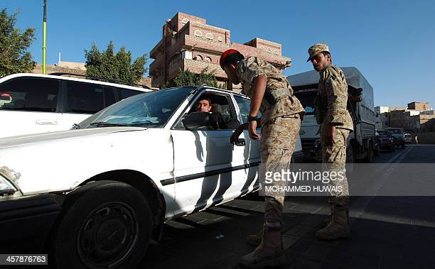 Yemeni security guards man a checkpoint in the capital Sanaa On December 19 2013 AlQaeda in the Arabian Peninsula has stepped up attacks on security...