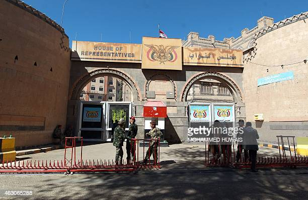 Yemeni security guards stand outside the parliament building in Sanna on February 9 after the Shiite Huthi militia dissolved parliament and created a...
