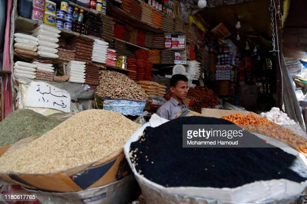 A Yemeni seller sits inside his spices shop waiting for customers at a market on October 12 2019 in Sana'a Yemen