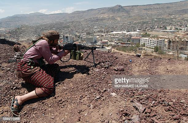 Yemeni Shiite Huthi anti-government rebel holds a position at an army base which they captured without resistance just hours before the signing a...