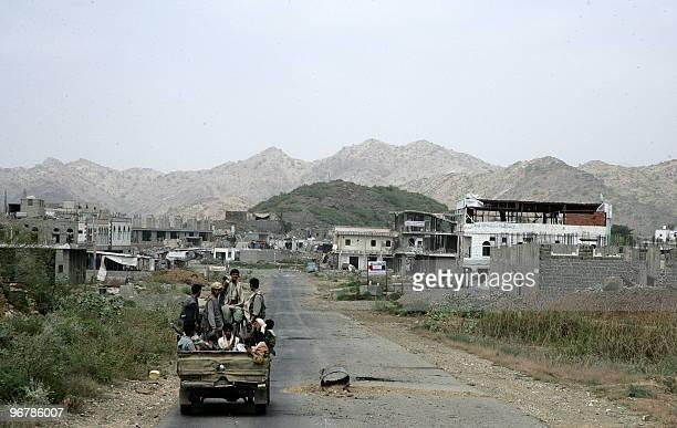 Yemeni Shiite Huthi rebels sitting atop a pick up pass through an area located in the Malahidh region near the YemeniSaudi border north of Sanaa on...