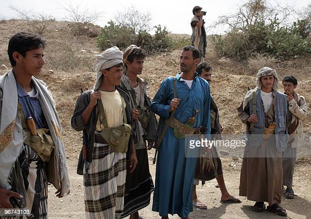 Yemeni Shiite Huthi rebels supervise the reopening of a road in Saada north of Sanaa on February 16 2010 following a truce between the rebels and...
