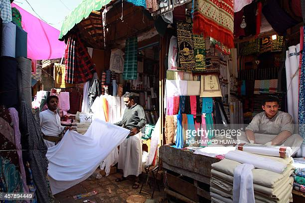 Yemeni shop keepers wait for customers in a market in Sanaa's old city on December 19 2013 AlQaeda in the Arabian Peninsula has stepped up attacks on...