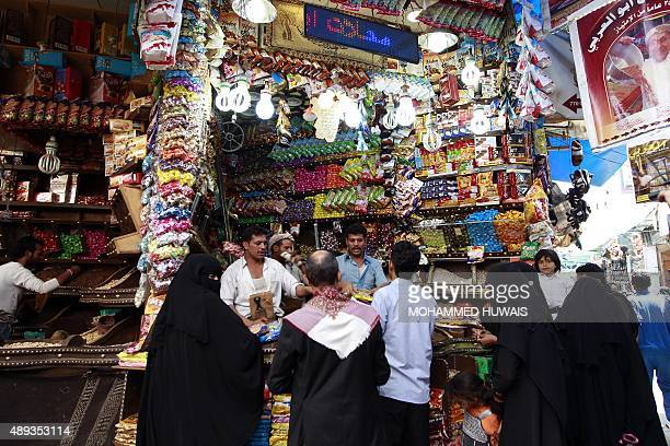Yemeni shop owners sell sweets in the capital Sanaa on September 20 as Yemenis shop in preparation of the major Muslim festival of Eid alAdha Muslims...