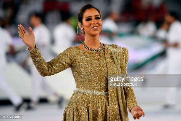 Yemeni singer Balqees Fathi performs during the opening ceremony for the 2019 AFC Asian Cup football competition prior to the game between United...